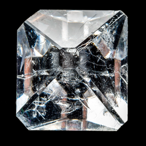 A clear, square-shaped crystal
